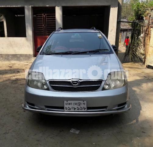 X Fielder Corolla 2003 - 2/5