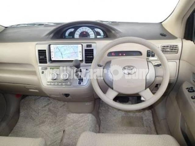 Toyota Raum 2010 - 3/4