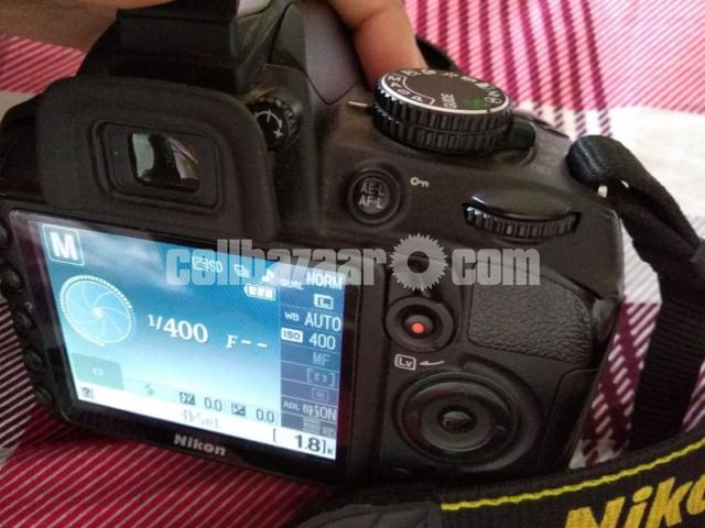DSLR Nikon D3100 (body only) - 1/2