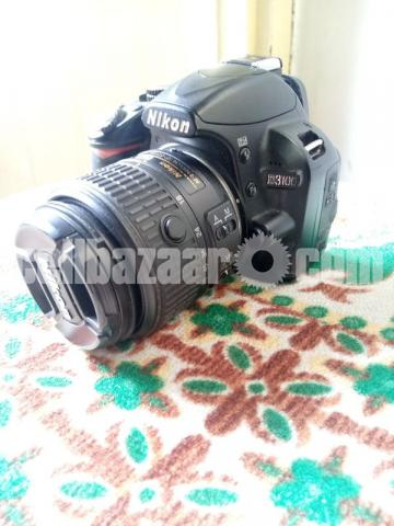Nikon D3100 with 18mm to 55mm kit lens - 2/4