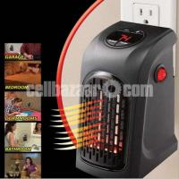 Portable Mini Handy Electric Fan Heater - Image 1/3