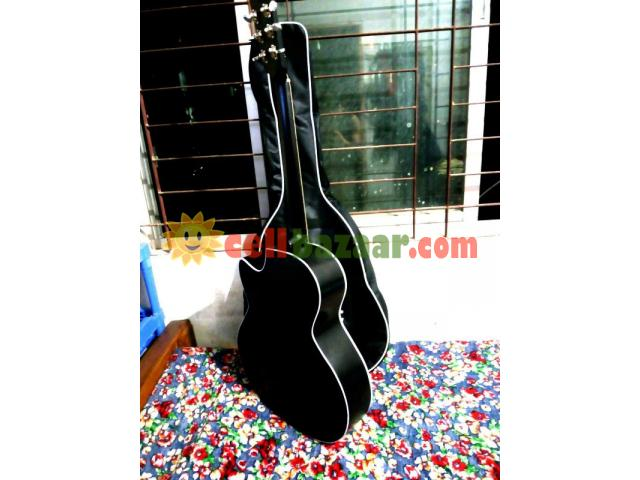 new Acoustic guiter with bag - 2/5