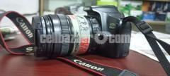 Canon 1300 D with 18/135 lence