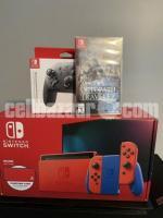 Nintendo Switch - Mario Red & Blue Edition - Switch  WHATSAPP: +19548663818