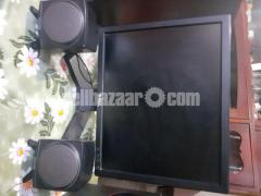 Intel core i3 desktop with monitor and soundbox