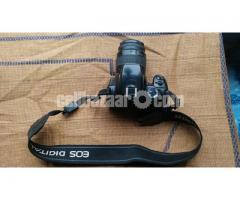 Canon 400D With 38-76 mm lens