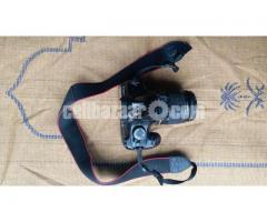 canon eos 1100D sathe paben 18-55 lense..