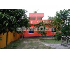 A fully furnished lake side bungalow with a beautiful garden in Modhumoti Model Town,  Dhaka.