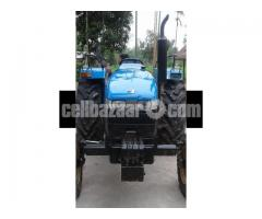 Mahindra tractor with plough