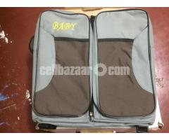 Folding travel baby bed cum bag