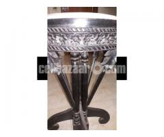 Round shaped antique table