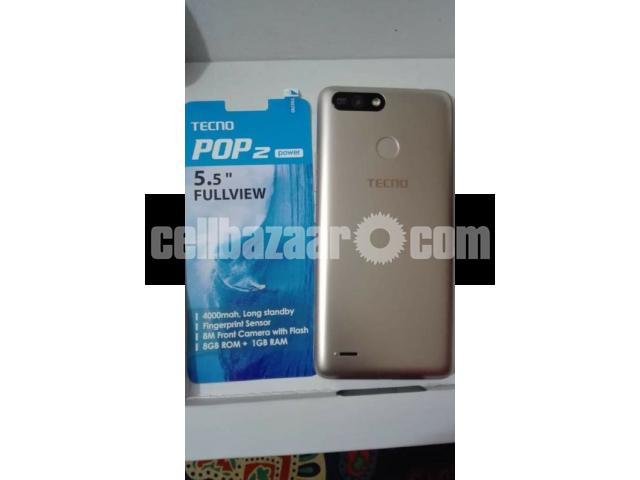 Tecno pop 2 power,Model-B1p intact cellphone with intact charger ,headphone  and backcover