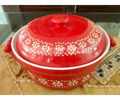 Red covered serving dish