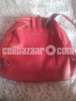 Red artificial leather bag