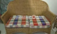 sofa, cane made