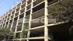 3.94 bigha land with 10 storied building for sale