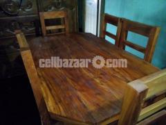 wooden dining table/ কাঠের ডাইনিং টেবিল।